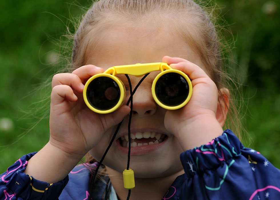 Girl with binoculars
